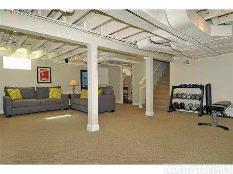 open ceiling painted white basement finish