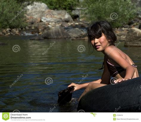 tube little girl young girl floating on tube royalty free stock images