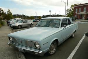 parked cars 1966 plymouth valiant 100