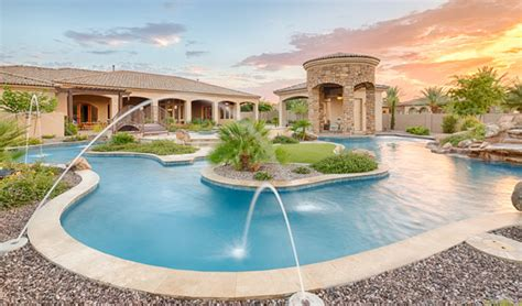 one end of pool with lazy river backyard oasis this gilbert luxury estate has its own lazy river