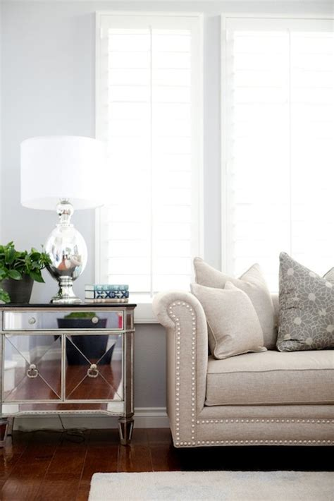 gray walls sofa mirrored cabinet transitional living room belmont