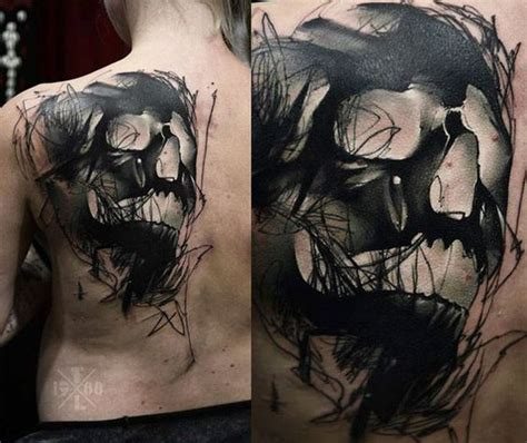 sketchy solid black skull upper back tattoo amazing