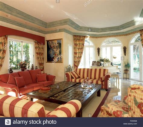 striped sofas living room furniture striped sofas set around carved wood coffee table in