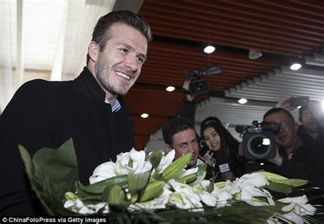 by frances kindon for mailonline david beckham flower david beckham mania in china day 2 football star has a