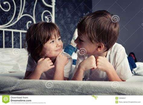 brother and sister in bed brother and sister on bed royalty free stock photography