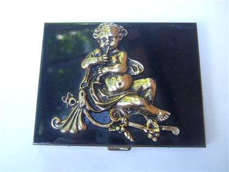 Fashion Bag Cig 08222 Black ornate gilt pan black enamel cigarette c 1950 at 1stdibs
