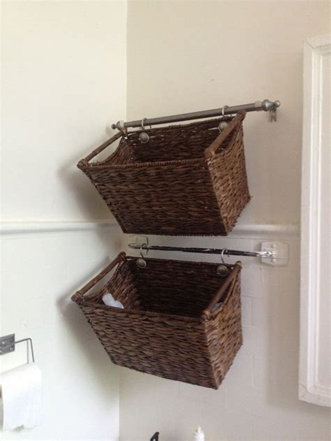 Using Shower Hooks To Hang Decorative Baskets From The Bathroom Storage Baskets Shelves