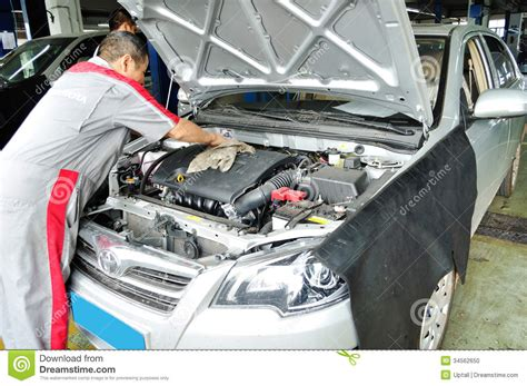 Toyota Auto Repair Worker Cleaning The Car Engine Editorial Image Image