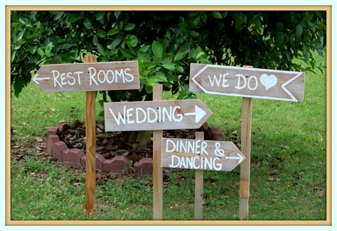 country cowgirl wedding signs with stakes outdoor wedding