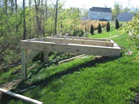 building a deck on a sloped backyard building a shed on a big slope the garage journal board