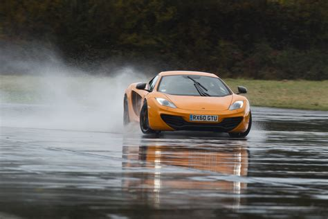 orange mclaren rear mclaren mp4 12c 2012 bright orange speed drift standing