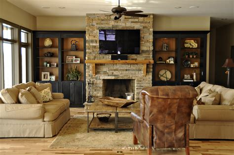 stone around fireplace bookcases around stone fireplace