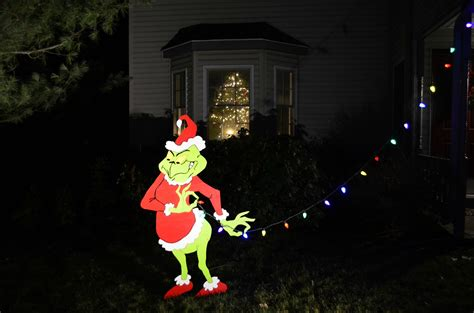 grinch taking down christmas lights christmas decor and
