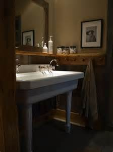 Rustic bathroom with deep double sink this generously sized bathroom