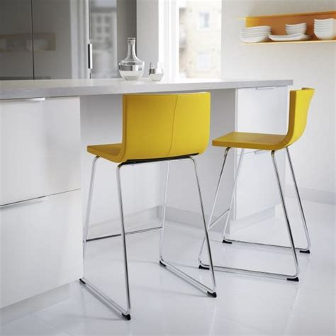 add color to a white kitchen and dining space with bright