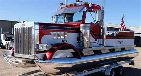 pontoon boat on car trailer peterbilt truck trades road for water becomes pontoon