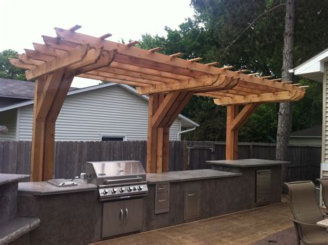 outdoor kitchen with cantilever pergola back yard