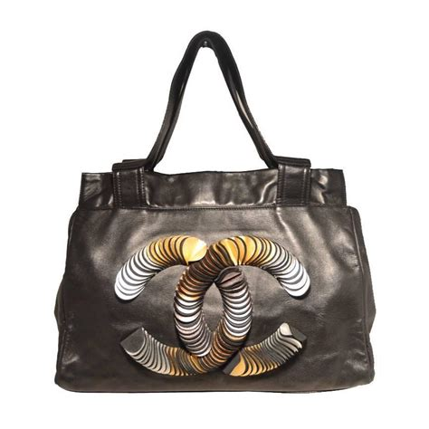 Purse Trend Black With A Touch Of Gold by Chanel Black Leather Gold And Silver Foil Cut Cc Logo Tote