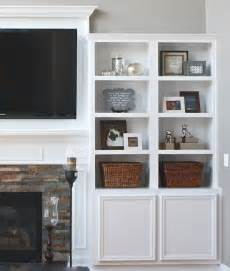 built in bookshelves around tv the yellow cape cod fireplace makeover
