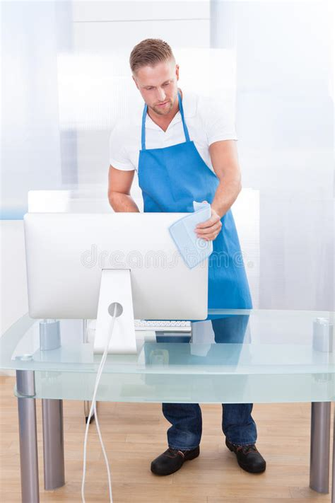 best cleaner for office desk janitor or cleaner cleaning an office stock photo image