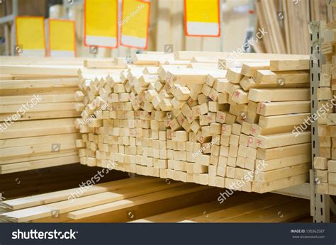 boards and beams lumber boards and beams of different sizes lie on racks