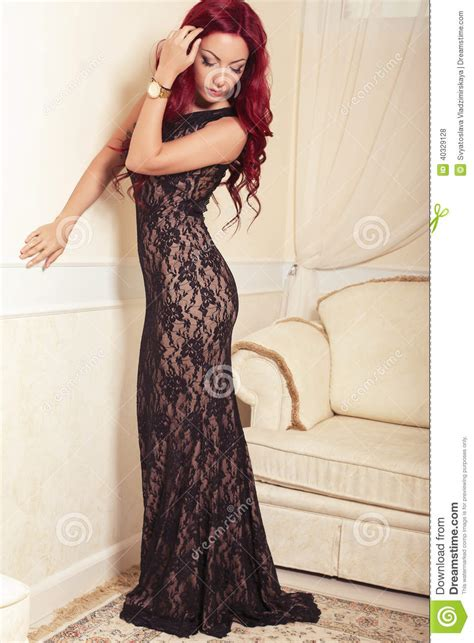 sexy bedroom dress up sexy woman with red hair in luxury dress posing at bedroom