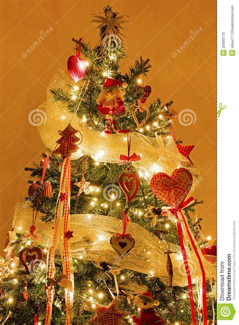 christmas tree with decorations and lights on stock photo