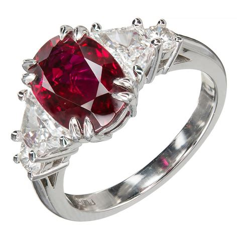 suchy oval ruby platinum engagement ring