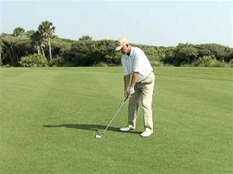 hitting or swinging golf how to swing a golf club how to hit long irons youtube