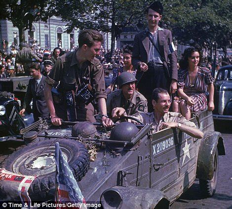 Left while journalists ride in a parade after the liberation of the