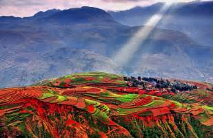 Colors the undulating and rolling hills adopt rainbow colors which