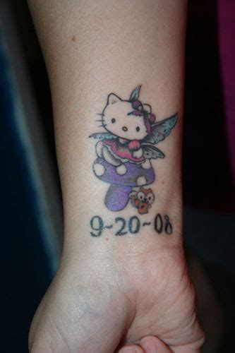 hello kitty wrist tattoos with small memorial on wrist
