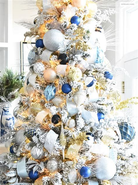 navy blue cheistmas dcorations flocked tree with navy light blue silver and gold ornaments