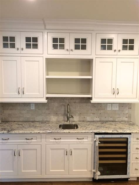 maple cabinets with white countertops quot ice white quot granite countertops with dynasty maple pearl