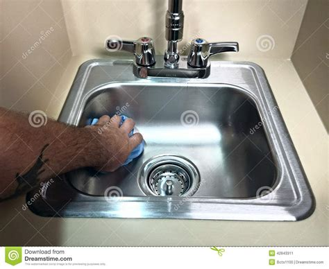 cleaning bathroom sink cleaning cleaning a bathroom sink stock photo image 42843311