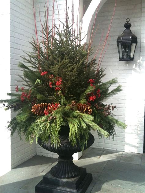 christmas decorating huge stone urns in front of entrance 1000 ideas about outdoor planters on planters urns
