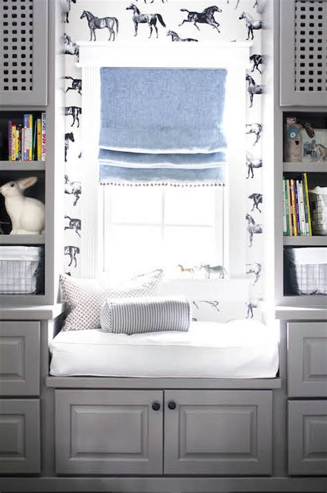 window seat flanked by bookcases horizonatl striped wallpaper transitional den library