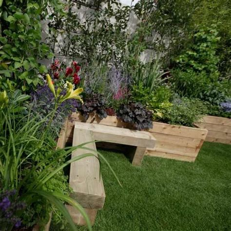 raised garden bed with bench seating cute corner seating area create a calming seating area in the corner of your garden