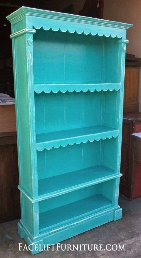 ornate bookshelf refinished in turquoise white glaze