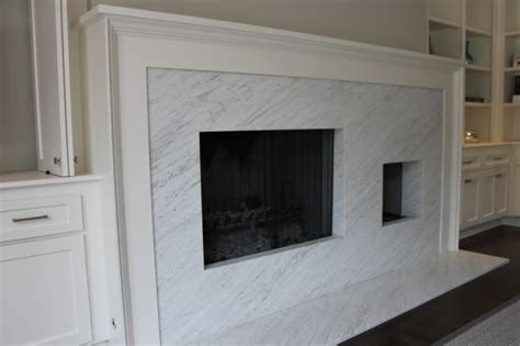 white facing fireplace surrounds with marble panel and