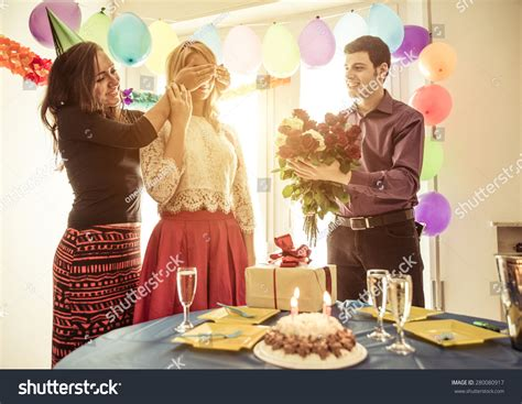 party at home birthday party home couple friend celebrating stock photo