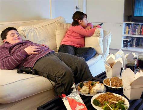 fat kid on couch obesity has reached alarming proportions in india in the