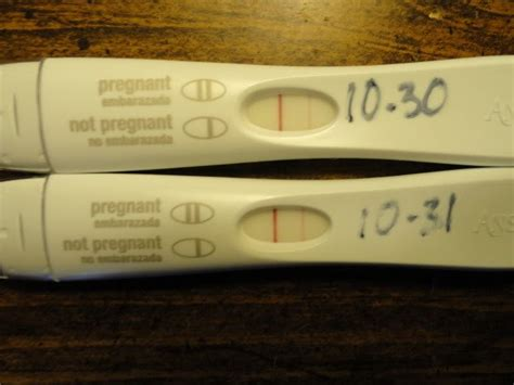 pregnancy test two lines one one light took two pregnancy tests both faint 2nd line am i