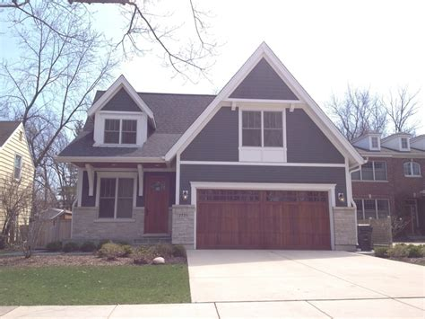 house with gray siding blue gray siding with medium wood garage and front doors house pinterest grey