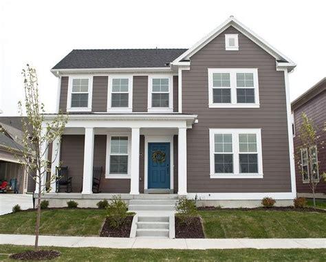 brown house  white trim  blue door  home