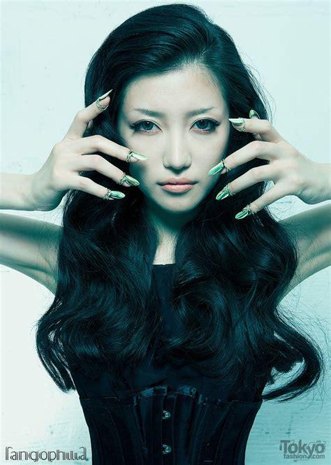 japanese model japanese model machiko wearing silver finger tips