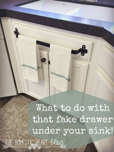 kitchen towel bar sink what to do with that drawer your kitchen sink
