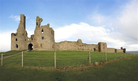 curtain wall on a castle file gatehouse and curtain wall of dunstanburgh castle