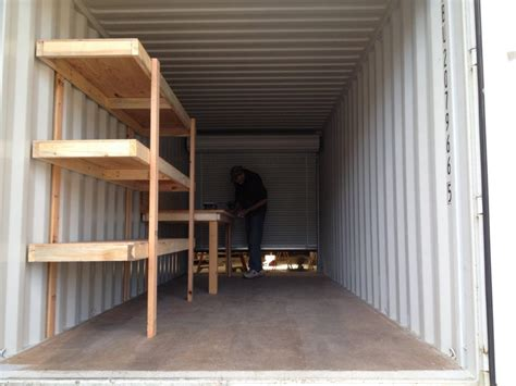 custom shelving and workbench in conex container simple