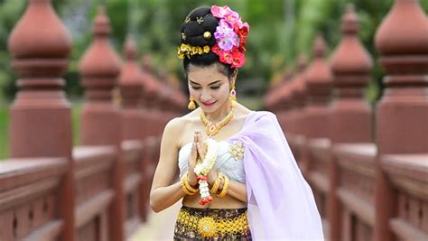 hd stock video footage two women flaunt tradition and thai woman salute of respect in traditional costume of